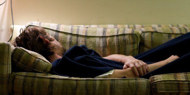 guy-sleeping-on-a-couch